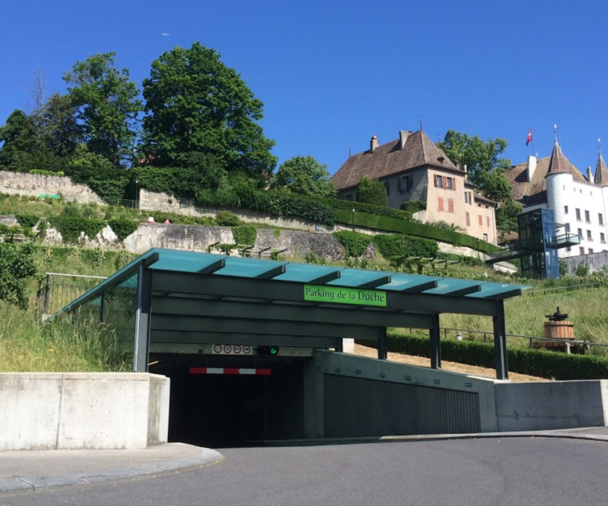 Entrance of Parking La Douche in Nyon with Nyon Castle in Background